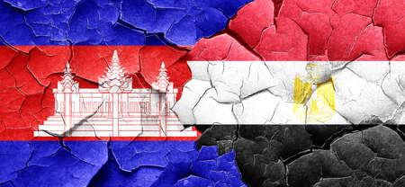 egypt flag: Cambodia flag with egypt flag on a grunge cracked wall