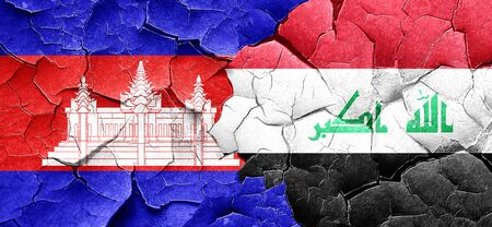 iraq conflict: Cambodia flag with Iraq flag on a grunge cracked wall