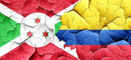 cracked wall: Burundi flag with Colombia flag on a grunge cracked wall