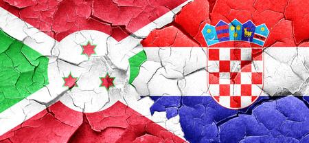bandera croacia: Burundi flag with Croatia flag on a grunge cracked wall