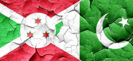 burundi: Burundi flag with Pakistan flag on a grunge cracked wall Stock Photo