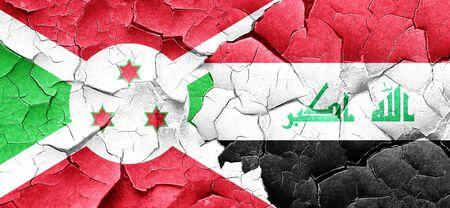 iraq war: Burundi flag with Iraq flag on a grunge cracked wall