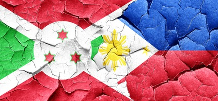philippino: Burundi flag with Philippines flag on a grunge cracked wall