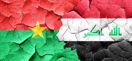 iraq conflict: Burkina Faso flag with Iraq flag on a grunge cracked wall Stock Photo
