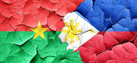 philippino: Burkina Faso flag with Philippines flag on a grunge cracked wall