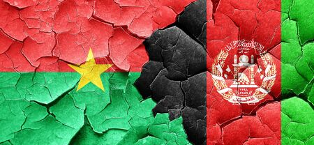 afghanistan flag: Burkina Faso flag with afghanistan flag on a grunge cracked wall