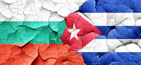cuba flag: bulgaria flag with cuba flag on a grunge cracked wall Stock Photo