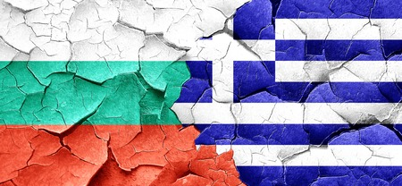 greece flag: bulgaria flag with Greece flag on a grunge cracked wall Stock Photo