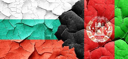 afghanistan flag: bulgaria flag with afghanistan flag on a grunge cracked wall