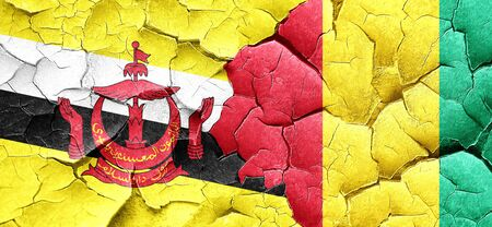 cracked wall: Brunei flag with Guinea flag on a grunge cracked wall