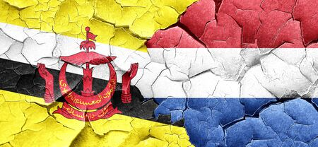 cracked wall: Brunei flag with Netherlands flag on a grunge cracked wall Stock Photo