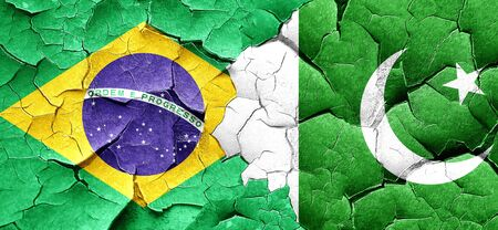 pakistan flag: Brasil flag with Pakistan flag on a grunge cracked wall Stock Photo