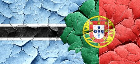 portugese: Botswana flag with Portugal flag on a grunge cracked wall