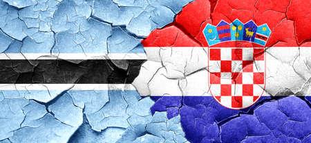 bandera croacia: Botswana flag with Croatia flag on a grunge cracked wall