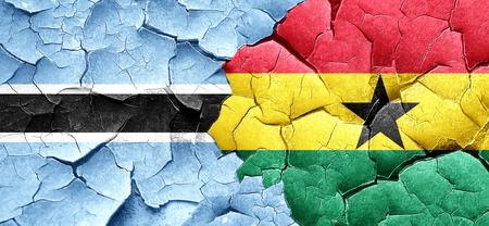 ghanese: Botswana flag with Ghana flag on a grunge cracked wall