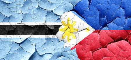 philippino: Botswana flag with Philippines flag on a grunge cracked wall