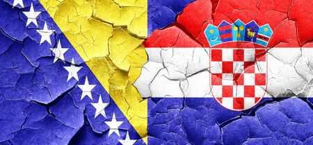 herzegovina: Bosnia and Herzegovina flag with Croatia flag on a grunge cracked wall
