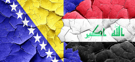 iraq conflict: Bosnia and Herzegovina flag with Iraq flag on a grunge cracked wall