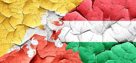 bhutan: Bhutan flag with Hungary flag on a grunge cracked wall