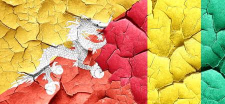 cracked wall: Bhutan flag with Guinea flag on a grunge cracked wall