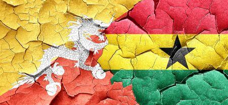 cracked wall: Bhutan flag with Ghana flag on a grunge cracked wall