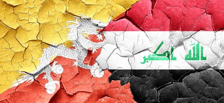 iraq war: Bhutan flag with Iraq flag on a grunge cracked wall