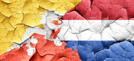 cracked wall: Bhutan flag with Netherlands flag on a grunge cracked wall
