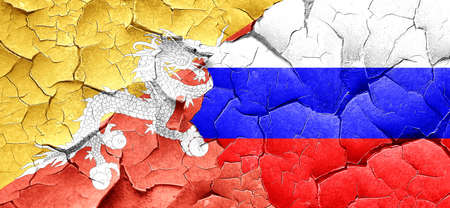 cracked wall: Bhutan flag with Russia flag on a grunge cracked wall