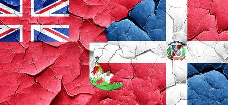 bermuda: bermuda flag with Dominican Republic flag on a grunge cracked wall Stock Photo