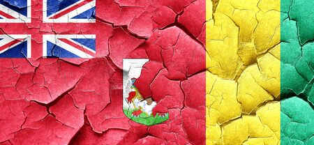 bermuda: bermuda flag with Guinea flag on a grunge cracked wall
