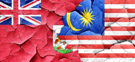 bermuda: bermuda flag with Malaysia flag on a grunge cracked wall Stock Photo