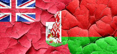 bermuda: bermuda flag with Belarus flag on a grunge cracked wall Stock Photo
