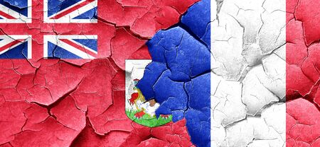 bermuda: bermuda flag with France flag on a grunge cracked wall
