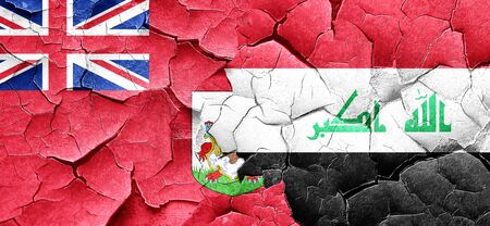 iraq conflict: bermuda flag with Iraq flag on a grunge cracked wall