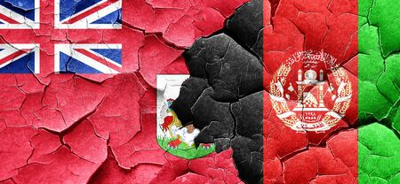 bermuda flag with afghanistan flag on a grunge cracked wall