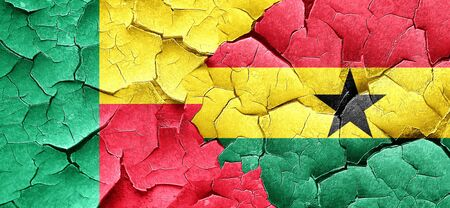 ghanese: Benin flag with Ghana flag on a grunge cracked wall