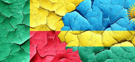 rwanda: Benin flag with rwanda flag on a grunge cracked wall