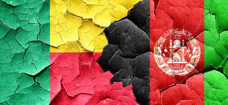 afghanistan flag: Benin flag with afghanistan flag on a grunge cracked wall