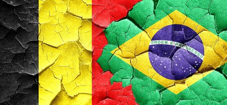 cracked wall: Belgium flag with Brazil flag on a grunge cracked wall