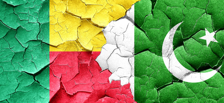 pakistan flag: Benin flag with Pakistan flag on a grunge cracked wall Stock Photo