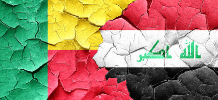 iraq war: Benin flag with Iraq flag on a grunge cracked wall Stock Photo