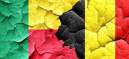 cracked wall: Benin flag with Belgium flag on a grunge cracked wall Stock Photo