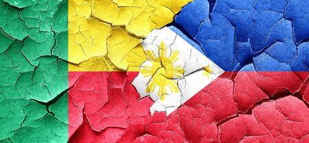 philippino: Benin flag with Philippines flag on a grunge cracked wall Stock Photo
