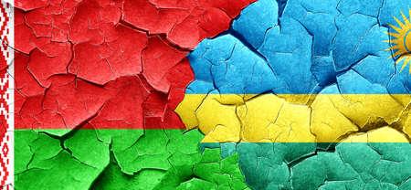 rwanda: Belarus flag with rwanda flag on a grunge cracked wall Stock Photo