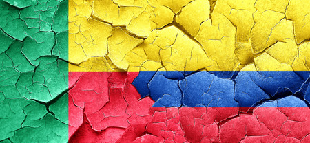 bandera de colombia: Benin flag with Colombia flag on a grunge cracked wall Foto de archivo
