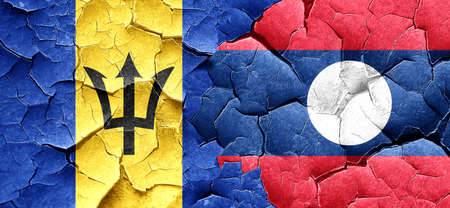 cracked wall: Barbados flag with Laos flag on a grunge cracked wall