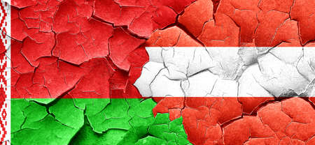 austria flag: Belarus flag with Austria flag on a grunge cracked wall