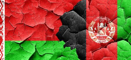 afghanistan flag: Belarus flag with afghanistan flag on a grunge cracked wall Stock Photo
