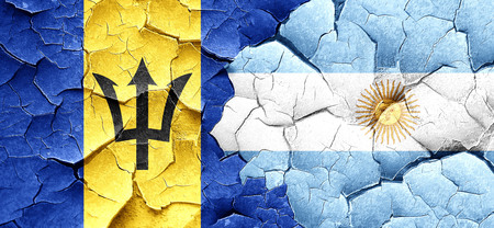 argentine: Barbados flag with Argentine flag on a grunge cracked wall
