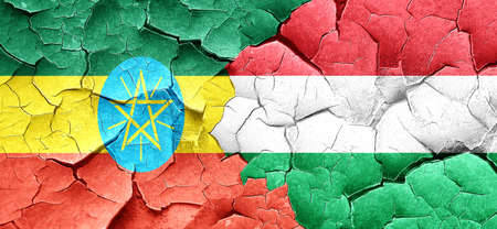 ethiopia  flag: Ethiopia flag with Hungary flag on a grunge cracked wall Stock Photo